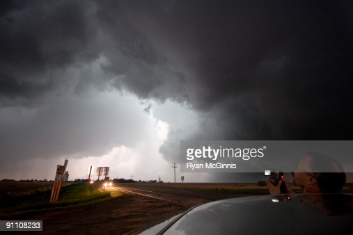 Storm Chaser looking up : Stock Photo