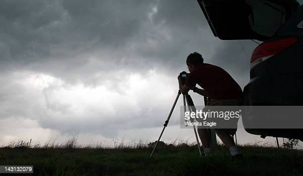 A storm chaser photographs a rotating thunderstorm just east of Pretty Prairie Kansas April 14 2012