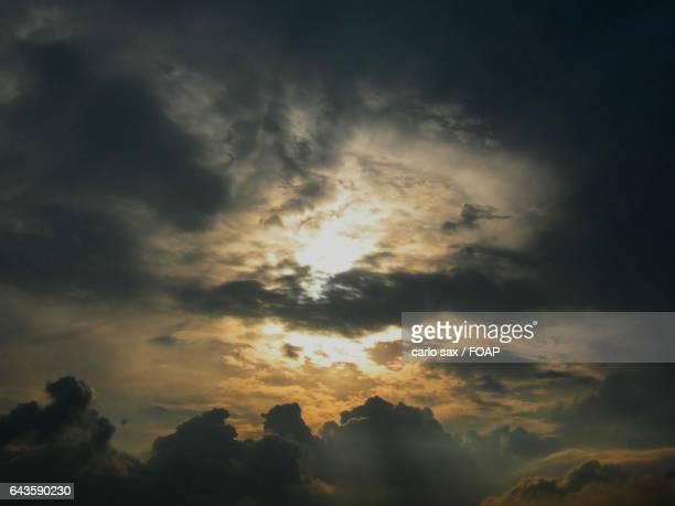 Storm cloud at sunset
