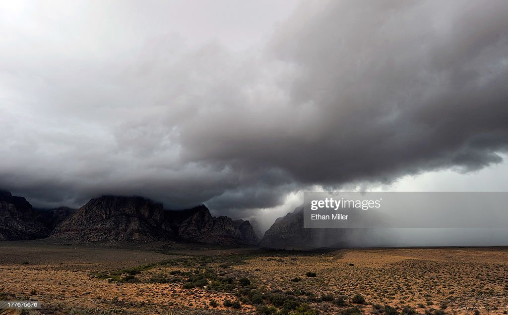 Storm clouds appear at the Red Rock Canyon National Conservation Area on August 25, 2013 near Las Vegas, Nevada. Moisture from Tropical Storm Ivo is causing heavy rains and flooding in parts of the Las Vegas Valley.