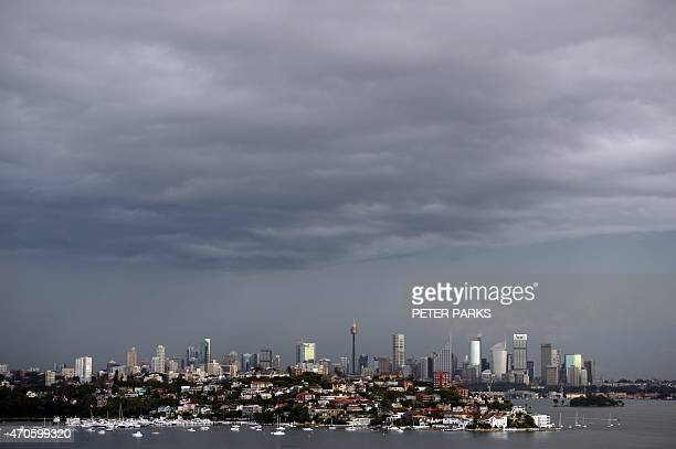 Storm clouds are seen over Sydney as the city battles cyclonic wind gusts and nonstop downpours on April 22 2015 Heavy rain and high winds battered...