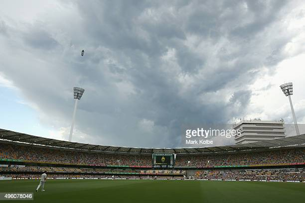Storm clouds build over the ground during day three of the First Test match between Australia and New Zealand at The Gabba on November 7 2015 in...