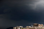 Storm clouds build over the Parthenon temple on Acropolis Hill in Athens Greece on Thursday May 28 2015 A failure to reach an agreement on Greece's...