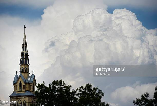 Storm clouds build up northwest of the Sacred Heart Catholic Church in Denver May 15 2015