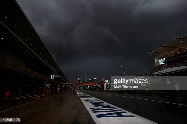 Storm clouds form over the pit lane after the afternoon practice session was suspended due to weather ahead of the United States Formula One Grand...