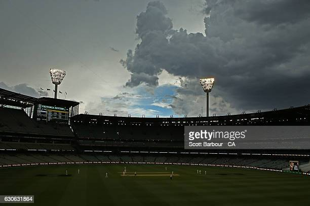 Storm clouds form overhead shortly before the players leave the field for a rain delay during day four of the Second Test match between Australia and...