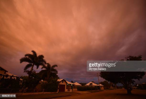 TOPSHOT Storm clouds gather in the town of Ayr in far north Queensland as Cyclone Debbie approaches on March 27 2017 Thousands of people including...