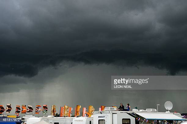 Storm clouds gather on the first official day of the Glastonbury Festival of Music and Performing Arts in Somerset southwest England on June 27 2014...