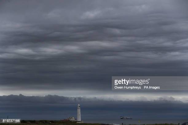 Storm clouds gather over St Mary's Lighthouse in Whitley Bay just off the North East coast as the unsettled weather continues