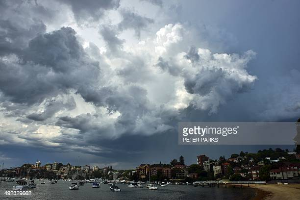 Storm clouds gather over the eastern suburbs of Sydney on October 12 2015 AFP PHOTO / Peter PARKS