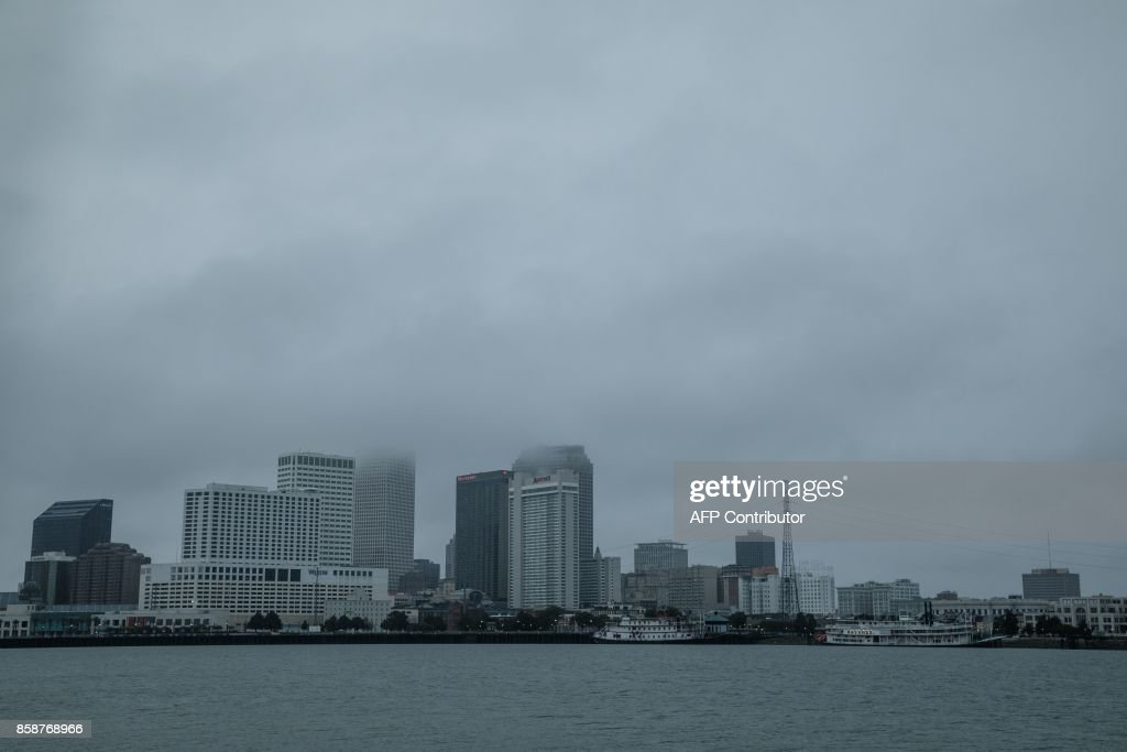 Storm clouds hang over downtown New Orleans as Hurricane Nate moves into Souther Louisiana on October 7, 2017. Residents in three states along the US Gulf Coast scrambled to complete preparations Saturday ahead of Hurricane Nate as officials warned conditions would turn treacherous after sunset. Nate was forecast to arrive late Saturday as a Category Two hurricane, packing winds topping 90 miles per hour as it churned in the Gulf of Mexico. The storm killed at least 28 people in Central America. PHOTO / Bryan Tarnowski