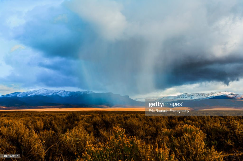 Storm clouds moving across rural prairie, Orovada, Nevada, United States : Stock Photo