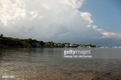 Storm clouds near coastal new england village stock photo for Ma fishing license cost