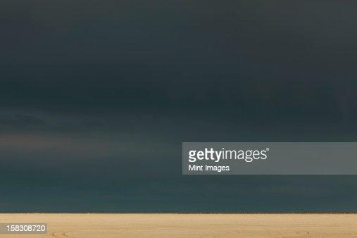 Storm clouds over Bonneville Salt Flats, dusk : Stock Photo