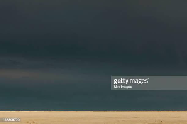 Storm clouds over Bonneville Salt Flats, dusk