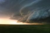Storm clouds over rural landscape