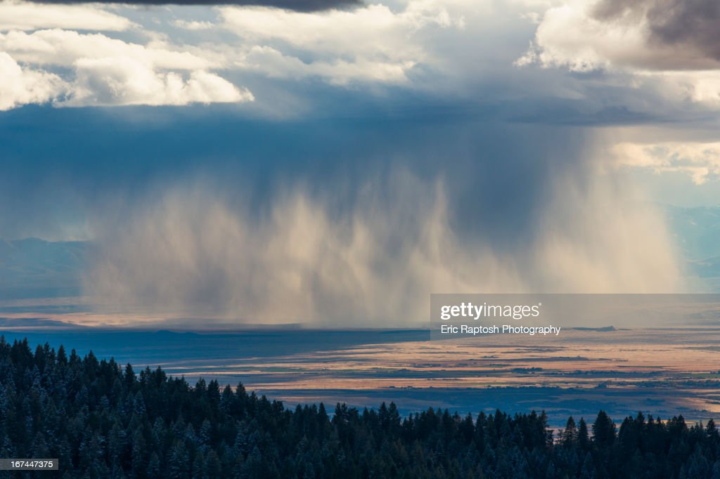 Storm clouds over rural valley : Stock Photo