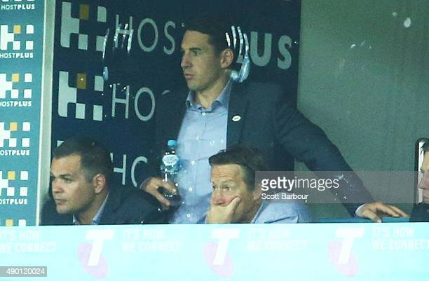 Storm coach Craig Bellamy and Billy Slater look on from the coaches box as the Cowboys score a try during the NRL Second Preliminary Final match...