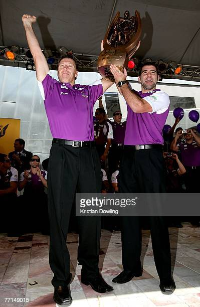 Storm coach Craig Bellamy and Cameron Smith hold aloft the premiership trophy during the Melbourne Storm NRL Grand Final Victory Parade on October 2...
