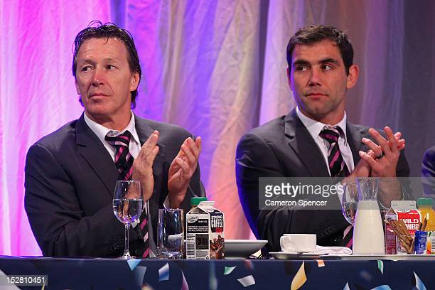 Storm coach Craig Bellamy and captain Cameron Smith applaud during the 2012 NRL Grand Final breakfast at Doltone House on September 27 2012 in Sydney...