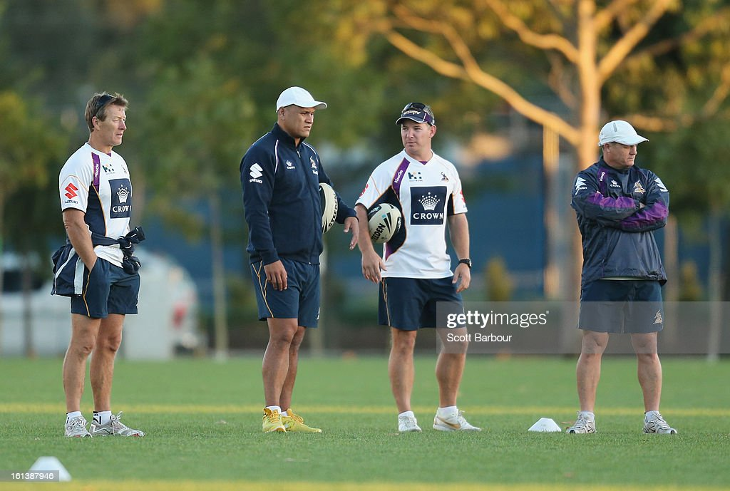 Storm coach Craig Bellamy, Assistant Coach <a gi-track='captionPersonalityLinkClicked' href=/galleries/search?phrase=David+Kidwell&family=editorial&specificpeople=176495 ng-click='$event.stopPropagation()'>David Kidwell</a>, Development Coach Adam O'Brien and Assistant Coach Kevin Walters look on during a Melbourne Storm NRL training session at Gosch's Paddock on February 11, 2013 in Melbourne, Australia.