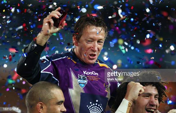 Storm coach Craig Bellamy celebrates with his team after the 2012 NRL Grand Final match between the Melbourne Storm and the Canterbury Bulldogs at...