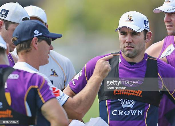 Storm coach Craig Bellamy gestures as Cameron Smith of the Storm looks on during a Melbourne Storm NRL training session at Gosch's Paddock on March 7...