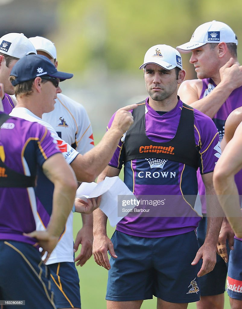 Storm coach Craig Bellamy (L) gestures as Cameron Smith of the Storm looks on during a Melbourne Storm NRL training session at Gosch's Paddock on March 7, 2013 in Melbourne, Australia.