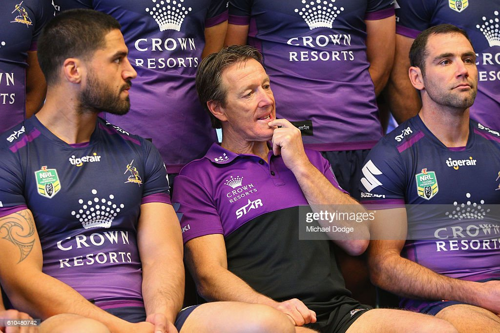 Storm coach Craig Bellamy looks thoughtful as poses for a team photograph with Jesse Brownwich (L) and Cameron Smith during a Melbourne Storm NRL media opportunity at AAMI Park on September 26, 2016 in Melbourne, Australia.