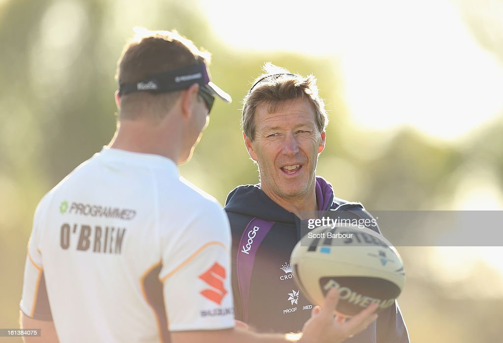 Storm coach Craig Bellamy (R) talks with Storm Development Coach Adam O'Brien during a Melbourne Storm NRL training session at Gosch's Paddock on February 11, 2013 in Melbourne, Australia.