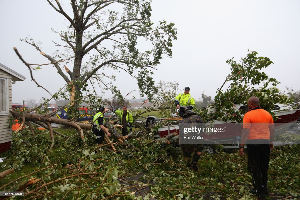 Storm debri is cleared from a boat in the aftermath of a tornado that hit the suburb of Hobonsville on December 6, 2012 in Auckland, New Zealand. Three people have been confirmed dead and torrential rain has caused surface flooding across Auckland.