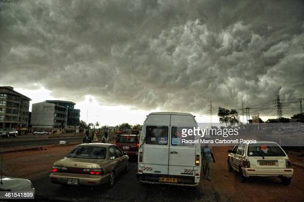 Storm over a streets full of cars
