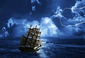 struggling from storm sailing-ship