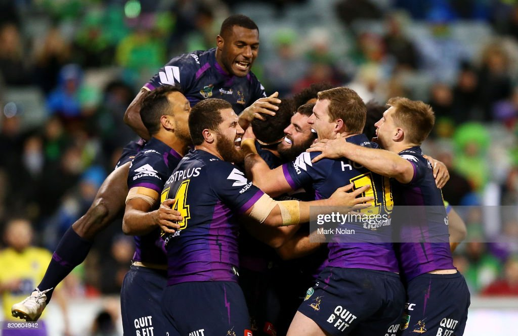 Storm players celebrate a try by Dale Finucane during the round 20 NRL match between the Canberra Raiders and the Melbourne Storm at GIO Stadium on July 22, 2017 in Canberra, Australia.