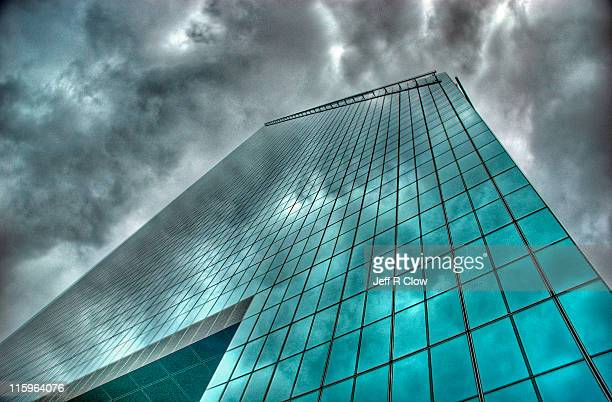 Storm reflections over glass skyscrapers