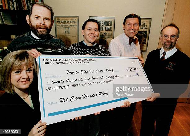 Storm relief Ontario Hydro staffers handed Star publisher John Honderich second from right a cheque for icestorm relief yesterday From left are Lynn...