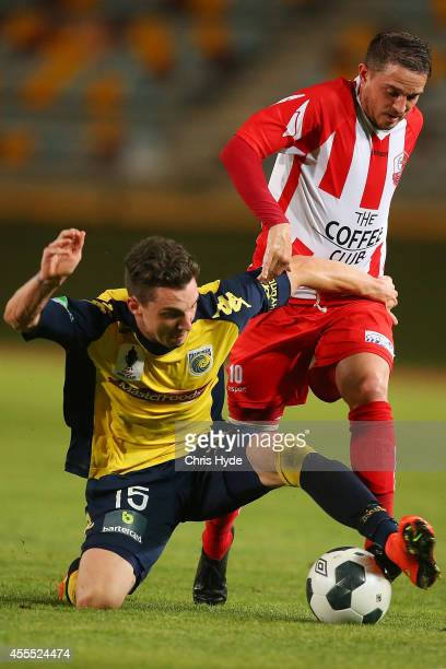 Storm Roux of the Mariners and Daniel Byrne of Olympic FC compete for the ball during the FFA Cup match between Olympic FC and the Central Coast...