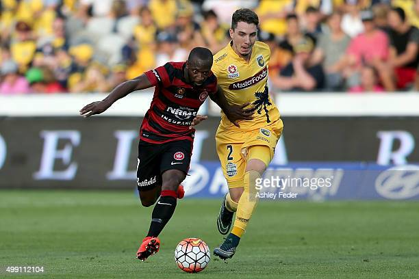 Storm Roux of the Mariners contests the ball against Romeo Castelen of the Wanderers during the round eight ALeague match between the Central Coast...