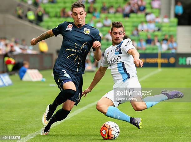 Storm Roux of the Mariners is tackled by Benjamin Garuccio of City during the round three ALeague match between Melbourne City FC and the Central...
