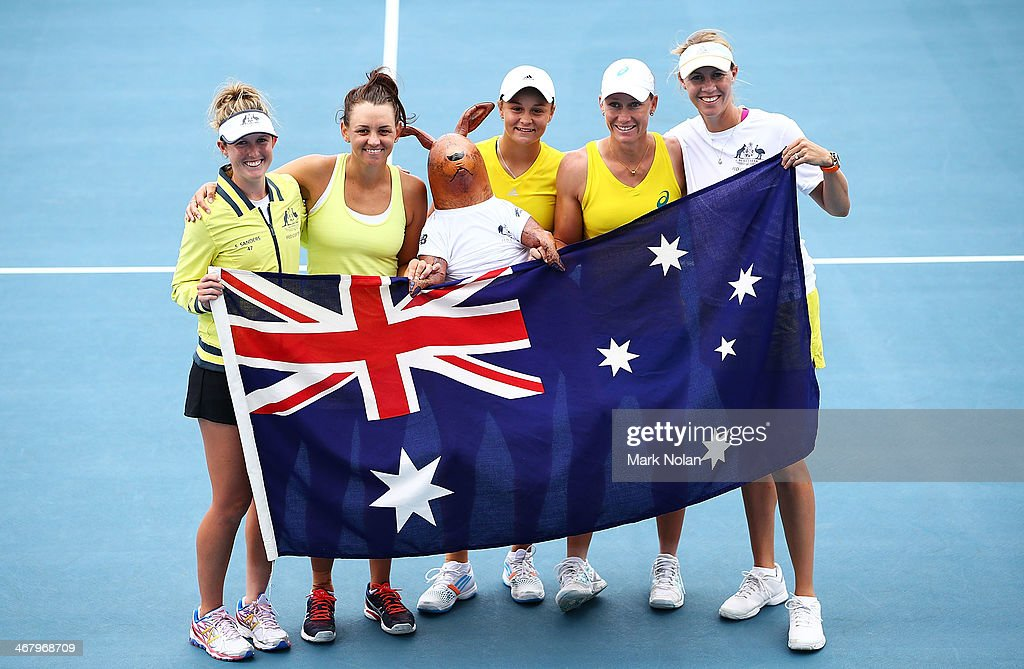 Storm Sanders, <a gi-track='captionPersonalityLinkClicked' href=/galleries/search?phrase=Casey+Dellacqua&family=editorial&specificpeople=575797 ng-click='$event.stopPropagation()'>Casey Dellacqua</a>, <a gi-track='captionPersonalityLinkClicked' href=/galleries/search?phrase=Ashleigh+Barty&family=editorial&specificpeople=7369424 ng-click='$event.stopPropagation()'>Ashleigh Barty</a>, <a gi-track='captionPersonalityLinkClicked' href=/galleries/search?phrase=Samantha+Stosur&family=editorial&specificpeople=194778 ng-click='$event.stopPropagation()'>Samantha Stosur</a> and <a gi-track='captionPersonalityLinkClicked' href=/galleries/search?phrase=Alicia+Molik&family=editorial&specificpeople=171158 ng-click='$event.stopPropagation()'>Alicia Molik</a> of Australia after the Fed Cup tie between Australia and Russia at the Domain Tennis Centre on February 9, 2014 in Hobart, Australia.