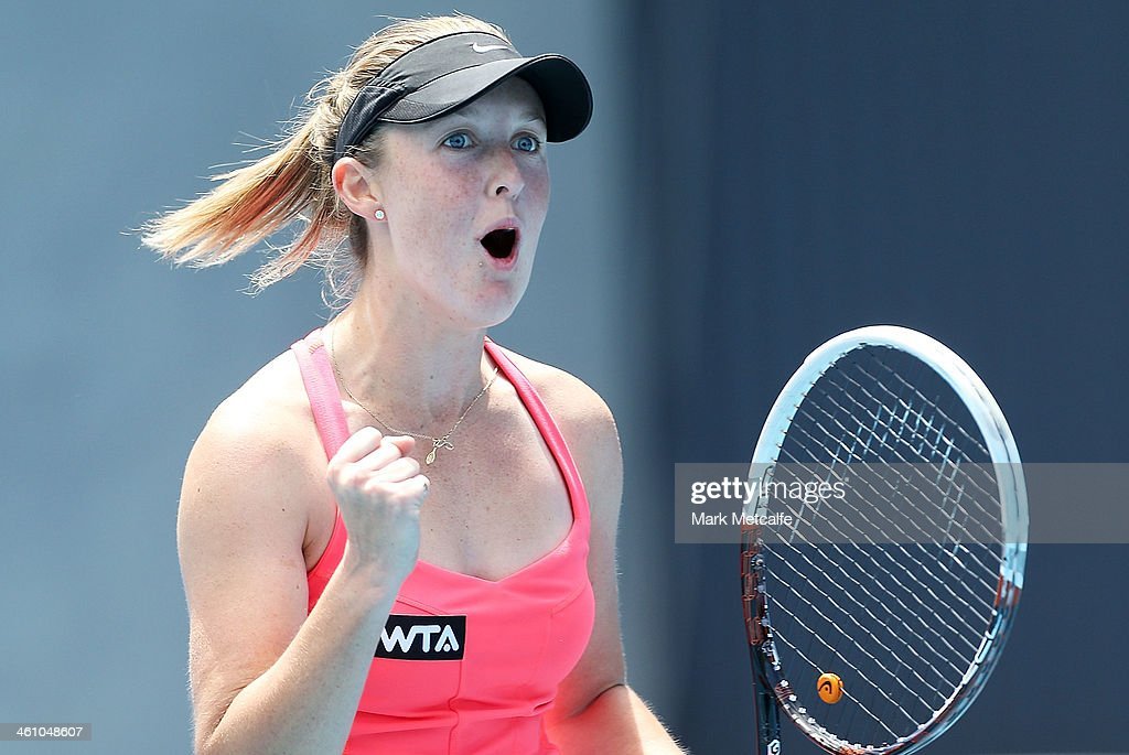 Storm Sanders of Australia celebrates winning match point in her first round match against Shuai Peng of China during day three of the Moorilla Hobart International at Domain Tennis Centre on January 7, 2014 in Hobart, Australia.