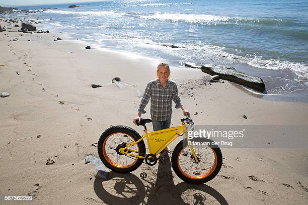 Storm Sondors with his electric eBike on the beach at his home February 13 2015 in Malibu Sondors is a Malibu surfer and successful businessman who...