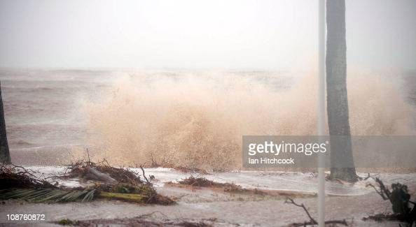 A storm surge sea wave breaks over an embankment in the suburb of Rowes Bay after the passing of Cyclone Yasi on February 3 2011 in Townsville...