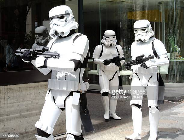 Storm Troopers pose at a toy shop for the promotion of the Star Wars goods in Tokyo on May 4 2015 May 4th is called the 'Star Wars Day' among Star...