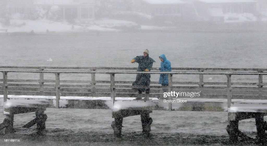 Storm walkers brave the footbridge across Lobster Cove in the Annisquam neighborhood of Gloucester, Mass. Feb. 9, 2013 as howling winds sweep the snow away.