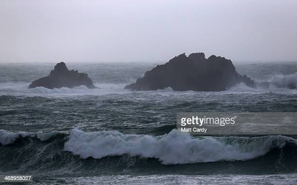 Storm waves are seen at Cape Cornmwall near Lands End on February 12 2014 in Cornwall England Parts of the UK are experiencing severe storms and...