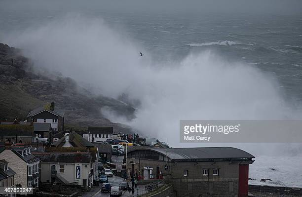 Storm waves break at Sennen on February 8 2014 in Cornwall England The UK is bracing itself for more storms and spells of rain over the weekend