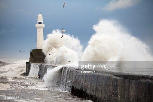 Storm waves striking the Aberdeen harbour breakwater, Scotland