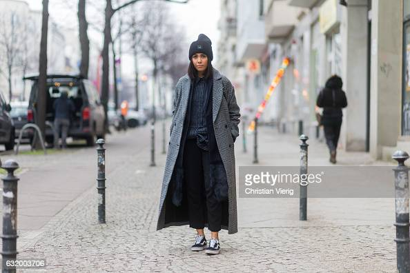 Storm Westphal wearing Acne beanie checked Asos coat navy coat Iris Ink button shirt Victoria Beckham cropped Topshop pants Vans Chloe bag during the...