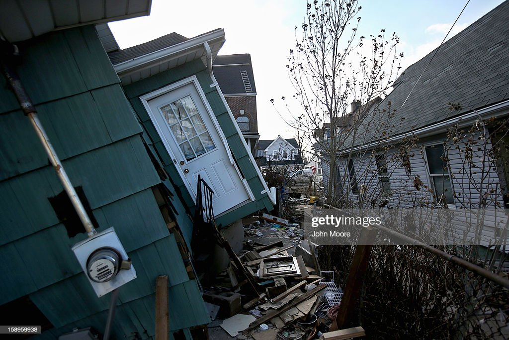 A storm-damaged home awaits demolition on January 4, 2013 in the New Dorp area of the Staten Island borough of New York City. More than two months after Superstorm Sandy, Congress passed legislation today that will provide $9.7 billion to cover insurance claims filed by people whose homes were damaged or destroyed by Sandy.